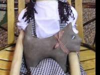 This is a hand-made primitive Dorothy doll with Toto
