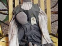 This is a hand-made primitive Mammy and Jasmine Doll