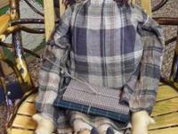 This is a hand-made primitive school girl doll with her