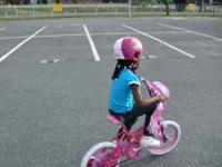 MY DAUGHTER HAS OUT GROWN THIS BIKE JUST SITTING IN