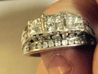 This ring is a size 7. It has 3 quads on top, princess
