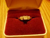 The main diamond is in excellent condition,.28 ct. It