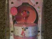 I am selling a princess music box. still in new package