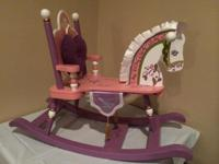 This is a colorful princess rocking horse! It is wooden