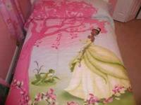 This is a Princess Tiana full size bed spread that has