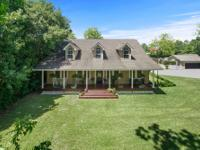 Pristine acadian home on nearly an acre Location: