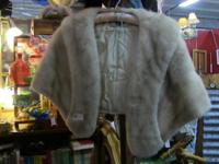 Excellent light fur cape in excellent condition. Bring