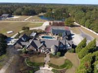 Exceptional, gated estate with 40 plus acres just three