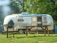 Airstream sleeper with futon, single bed, fridge.
