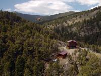 Beautiful log home with over 2,000 Sq. Ft on 320 very