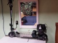 Barely used propane ProGo scooter. Runs on little green