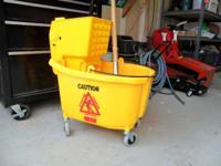 Brand new Professional grade Mop Buckets.  // //]]>