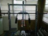 proform smith machine with about 350 pounds of Olympic