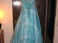I am selling my blue prom dress for 200.00 obo. i