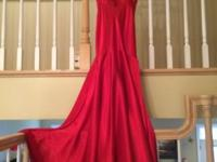 Elegant red gown with rhinestones from Bella Boutique.