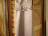 Light cocoa colored satin gown with lovely beading.