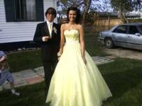 I have a beautiful yellow prom dress with hand stitched