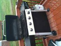 Four burner grill with side burner, with propane tank