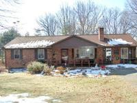 Nice brick ranch home with 1 acre of land.ere's a 3