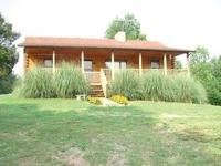 IMMACULATE CABIN ON APPROXIMATELY 50 AC. IN SERENE