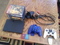 $100 obo. PS2 Slim in great cond. w/ all setup cables,