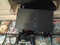 I acquired a ps2 containing 1 controller and 32 games