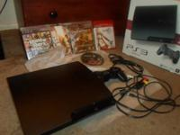 PS3 for sale like new in new box with 5 games  Grand