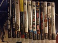 PS3 game system with 12 games & 2 guide books. The