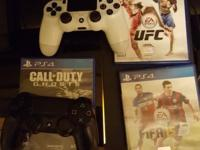 PS4 with 2 controllers, and 4 games, mortal Kombat (the