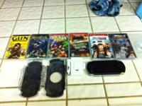 PSP with case, charger and 7 games. Spent over $300 on