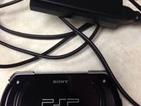 Like new condition PSP with 6 downloaded games.   The