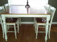 Large solid wood pub table with 4 chairs. Given that