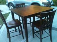Pub Table and 4 chairs, new, never used. Please CALL