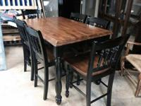 Pub Table With 6 Chairs. $1200.   INVIO FINE