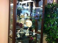Beautiful curio cabinet.  Glass and mirror with light