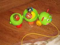 Pull behind caterpillar toy with accessories. Used in