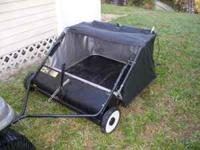 Pull behind lawn sweeper in excellent conditon. If