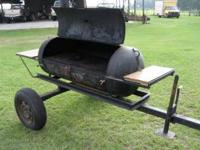 Smoker/grill that can be pulled behind vehicle. Cooking