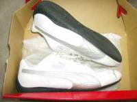 WHITE AND GRAY PUMA SHOES WORN A FEW TIMES LIKE NEW