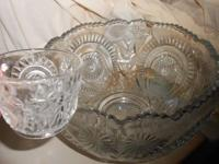 This large glass punch bowl set includes a base, 25