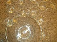 Glass punch bowl with 16 glasses with small handles.