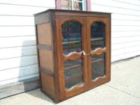 This is a old punched tin kitchen pie cabinet. it is 38