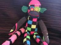 These are adorable sock monkeys with a punky edge. I