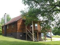 LOG CABIN HOME FOR SALE: Totally remodeled log home,