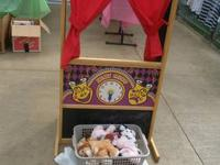 Very cool 3sided puppet theatre. Here is the link from