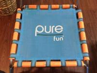 This is a kids trampoline, made by Pure Fun. It has a