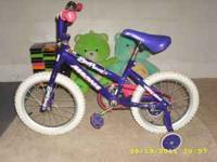 "We are selling a 14"" Magna purple girls bike. It is in"