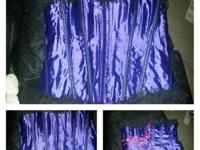 Purple 4x corset with black lace trim. Strong metal