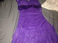 Purple sparkly dress from Deb. It is a halter top.