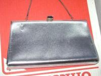 This clutch purse is in excellent condition.It can be